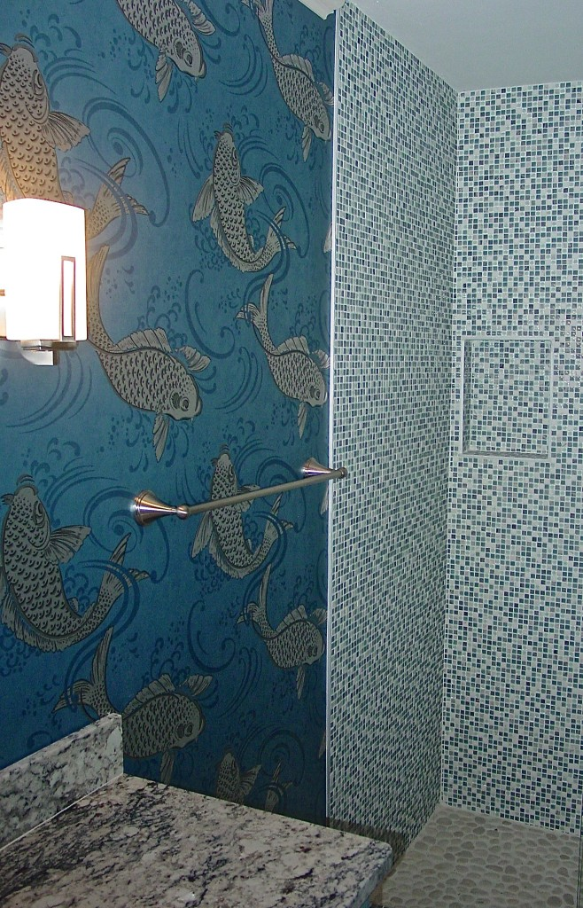 Silvery Koi jump and leap on a beautiful glimmering wallpaper from Osborne & Little called Derwent.